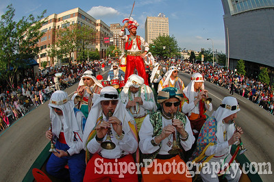 The Shriner Band honks out a tune while driving down Broadway during the Pegasus Parade.