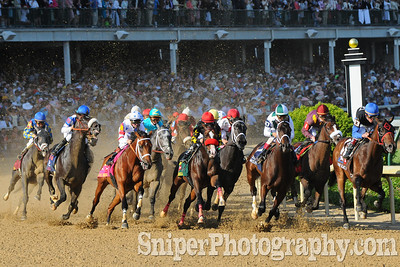 Big Brown leads the field around the first turn of Churchill Downs during the 134th Kentucky Derby.