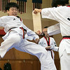 Reingold Elementary School in Fitchburg got a visit from The Korean National Taekwondo Demo Team who did some demonstration for the students on Tuesday, Oct. 8, 2019. Taekwondo student Seugchan Jeon brakes some boards during the demonstration. SENTINEL & ENTERPRISE/JOHN LOVE