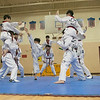 Reingold Elementary School in Fitchburg got a visit from The Korean National Taekwondo Demo Team who did some demonstration for the students on Tuesday, Oct. 8, 2019. A student brakes some boards during the demonstration. SENTINEL & ENTERPRISE/JOHN LOVE