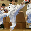 Reingold Elementary School in Fitchburg got a visit from The Korean National Taekwondo Demo Team who did some demonstration for the students on Tuesday, Oct. 8, 2019. Taekwondo student Gyuchan Kim performs during their visit. SENTINEL & ENTERPRISE/JOHN LOVE