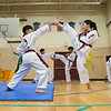 Reingold Elementary School in Fitchburg got a visit from The Korean National Taekwondo Demo Team  who did some demonstration for the students on Tuesday, Oct. 8, 2019. Taekwondo students perform some moves during the demonstration. SENTINEL & ENTERPRISE/JOHN LOVE