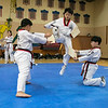 Reingold Elementary School in Fitchburg got a visit from The Korean National Taekwondo Demo Team who did some demonstration for the students on Tuesday, Oct. 8, 2019. Taekwondo student Seungmin Cho brakes a board during the demonstration. SENTINEL & ENTERPRISE/JOHN LOVE