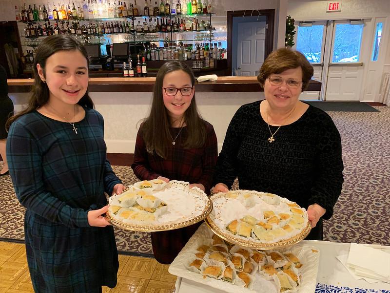 From left, Malyna Skafidas, Toula Stavrou and Eleni Stavrou, all of Dracut, show off their delicious spanakopita.