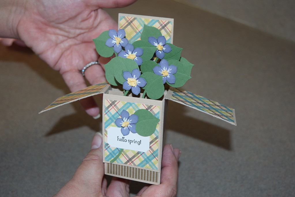 . Craft instructor Sue Elwart displays a pop-up card created by members of the Lake House in St. Clair Shores.