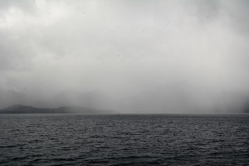 A very heavy rain shower coming towards the boat.