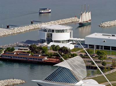 Wisconsin's clipper ship the Denis Sullivan heads for it's Summer home at Discovery World on Milwaukee's lakefront. In the foreground,the Calatrava addition to the Milwaukee Art Museum. June 2009