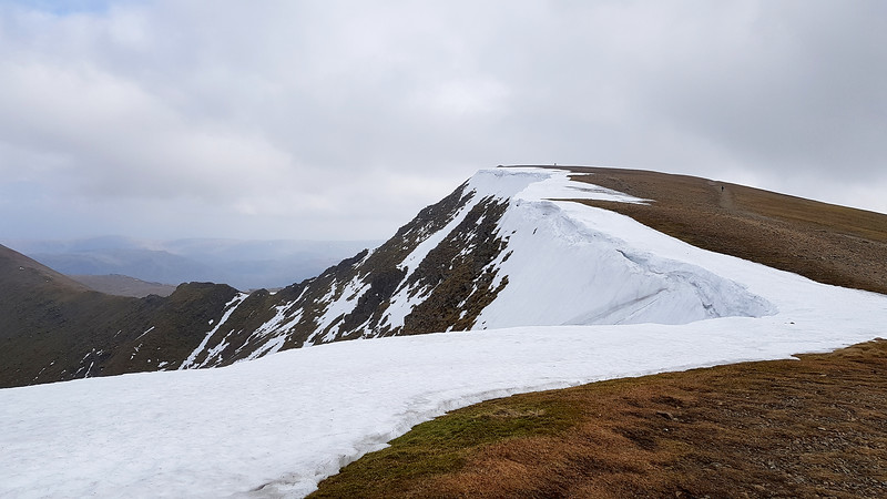 The view back to the summit of Helvellyn still carrying a mantle of snow