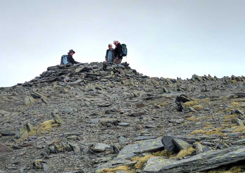 After a stiff climb up the scree strewn path the summit plateau is reached