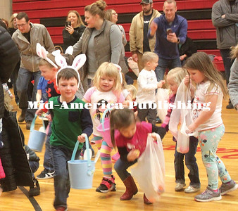 """Faster than you can say """"Peter Cottontail"""" colorful Easter eggs disappeared into baskets and sacks at the annual WA TAN YE Club Easter Egg Hunt at Garner, Saturday morning.  The event was moved inside to the Garner-Hayfield-Ventura Elementary gym due the chilly, windy weather. The candy-filled eggs gone in about 45 seconds. Afterwards, WA TAN YE members delivered Easter treats to residents at Concord Care Center and Cardinal Grove Assisted Living. Rebecca Peter 