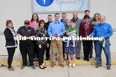 Curran McLaughlin | The Leader Members of Britt Chamber pose with Dr. Brady Wilson, Hilary Wilson and their daughter Beverly as they prepare to cut the ribbon at the grand opening of Victory Chiropractic on Thursday.