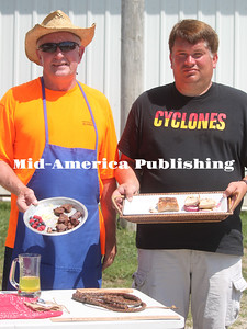 Rich Wilhelm (left) and Tim DeWaard participated in the Farm Bureau Cookout Contest at the Hancock County District Fair. Wilhelm grilled marinted teriyaki steak cubes and earned showmanship recognition. DeWaard was named grand champion for his grilled pork loin. Rebecca Peter|The Leader