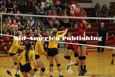 Curran McLaughlin | The Leader Sydney Burgardt goes up to make a block. In West Hancock's game against Lake Mills on Thursday, Burgardt had seven solo blocks and 10 total.