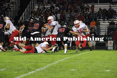 Curran McLaughlin | The Leader Chase Eisenman tries to evade defenders in the backfield.