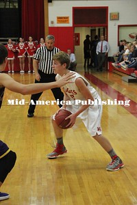 Curran McLaughlin | The Leader Gavin Becker looks for a pass at home against Lake Mills on Nov. 28.