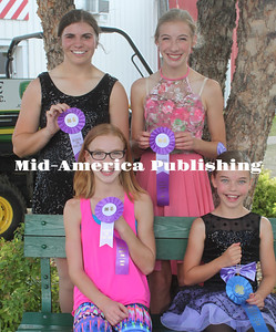 Four Hancock County 4-H'ers shared the fun with dance routines at the Hancock County Fair. Elise Wirtjes (seated, left) will take her jazz dance number to the Iowa State. Allison Wirtjes was awarded a Super Blue ribbon for her tap dance. Elise and Allision are members of the Orthel Jolly Workers. Natalee Dippel (standing, left), a member of the Elcon Indians, and Anna Wirtjes, Orthel Jolly Workers, will also go to the Iowa State Fair. Natalee was selected for her clogging dance. Anna performed a ballet dance number.