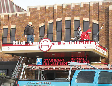 A crew from Mason City Roofing made repairs to the canopy of the Avery Theater in Garner last week. The Avery was recently was listed as #6 of Ten Best Historical Theatres in Iowa by American Towns Media, a marketing firm. Rebecca Peter | The Leader