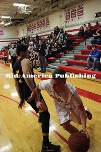 Curran McLaughlin | The Leader Nathan Cabrera reaches for a GHV wrestlers' ankle to defend a shot.