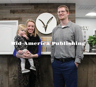 Curran McLaughlin | The Leader Dr. Brady Wilson and Hilary Wilson with their daughter Everly at the Victory Chiropractic office on Main Ave.