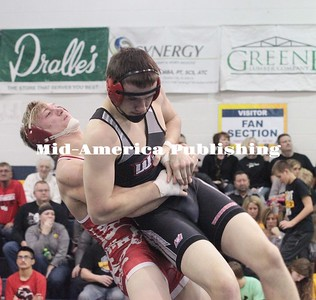Kristi Nixon | Mid-America Publishing Hunter Hagen of West Hancock picks up West Fork's Collin Meints for a takedown in the 195-pound semifinal of the Doug Trees Invite at North Butler High School last weekend to advance to the final.