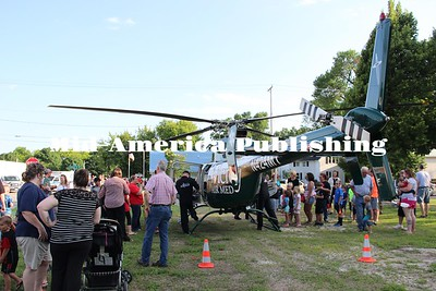Curran McLaughlin | The Leader A crowd forms around the Mercy Air Med helicopter which made an appearance at the annual West Hancock Ambulance Service barbecue on Wednesday in Britt.