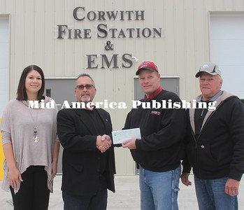 Corwith Fire Chief Rich Wagner accepts a check from Prairie Energy Cooperive in cooperation with Cornbelt Power, Basin Power Cooperative and Co-Bank for a total $4,000 towards the new Corwtih Fire Station & EMS building project. From left: Brittany Dickey of Cornbelt Power, Todd Foss of Prairire Energy, Rich Wagner and Mayor Dave Wagner. Leader photo by Rebecca Peter