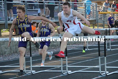 Curran McLaughlin | The Leader Josef Smith leaps over hurdles in the 110 meter hurdle event.