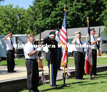 Curran McLaughlin | The Leader Color Guard plants the American flag and Iowa State Flag.