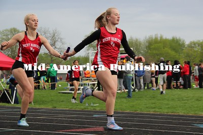 Curran McLaughlin | The Leader Emily Ryerson exchanges with Sydney Hudspeth in Nashua-Plainfield at the District meet.