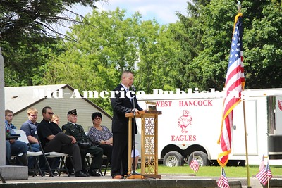 Curran McLaughlin | The Leader Pastor Chris Burrell of the Zion Church of the Nazarene gives a speech for the Memorial Day ceremony in Evergreen Cemetery in Britt.