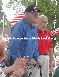 World War II veterans Harlan Johnson and Maynard Isenberger stand for recognition of  their service to the country at the 2017 Memorial Day Service at Garner.