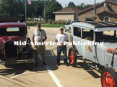 Landon Evanson | The Leader Tom Deibler of Garner (left) and Ace Folkerts of Duncan (right) pose with their 1931 and '29 Model A's, respectively, outside the Hobo Museum in Britt at the 21st Great Annual Model A Ride Around Iowa on September 15.
