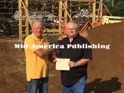 Landon Evanson | The Leader Corwith mayor Dave Wagner (left) receives a check from Randy Epting (right), Complex anager for Hawkeye Pride Egg Farm to help fund the new firehouse.