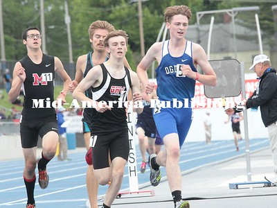 Kristi Nixon | MAPC Reece Smith of GHV and Andrew Stumbo of Ogden battle at the bell lap of the 3,200 on Thursday, May 18. Smith was runner-up.