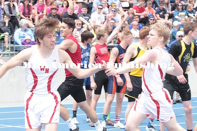 Kristi Nixon photo Dylan Eckels takes the hand off from Bennett Bruns for West Hancock in the 4x800 on Thursday, May 18.