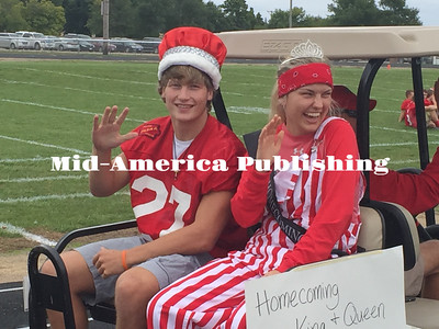 Landon Evanson | The Leader Homecoming royalty ride Jordan Weiland (King) and Bailee Leerar (Queen) roll through the West Hancock Homecoming parade in style.