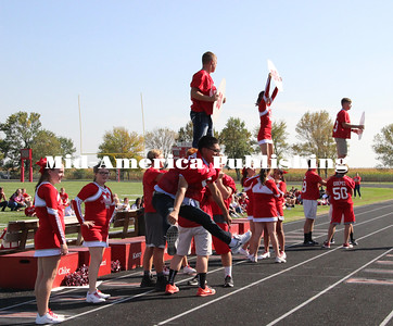Curran McLaughlin | The Leader Cheerleaders perform stunting maneuvers.