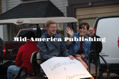 Curran McLaughlin | The Leader The Homecoming Court rode on golf carts in the parade. Pictured Lucas Weiland and Jade Oberhelman.