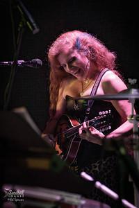 Happy woman with a mandolin