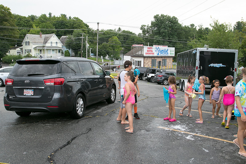 The Lunenburg Bengals cheerleading team held a car wash funraiser in the parking lot of Central Mass Powersports for the sixth year on Saturday, August 3, 2019. They are a big sponsor of the team. The team is made up of kids from kindergarten to eighth grade. Kids with soapy sponges wait for a car to pull up during the fundraiser. SENTINEL & ENTERPRISE/JOHN LOVE