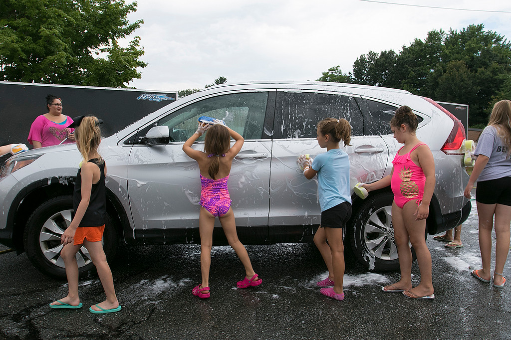 . The Lunenburg Bengals cheerleading team held a car wash funraiser in the parking lot of Central Mass Powersports for the sixth year on Saturday, August 3, 2019. They are a big sponsor of the team. The team is made up of kids from kindergarten to eighth grade. Cheerleaders, coaches and family members helped wash the cars during the event. SENTINEL & ENTERPRISE/JOHN LOVE