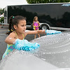 The Lunenburg Bengals cheerleading team held a car wash funraiser in the parking lot of Central Mass Powersports for the sixth year on Saturday, August 3, 2019. They are a big sponsor of the team. The team is made up of kids from kindergarten to eighth grade. Elisia Tau Golden, 8, with two hand scrubbers helps makes sure this car was clean during the fundraiser. SENTINEL & ENTERPRISE/JOHN LOVE