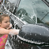The Lunenburg Bengals cheerleading team held a car wash funraiser in the parking lot of Central Mass Powersports for the sixth year on Saturday, August 3, 2019. They are a big sponsor of the team. The team is made up of kids from kindergarten to eighth grade. Ella Tau Gooden, 7, washes one of the cars at the fundraiser. SENTINEL & ENTERPRISE/JOHN LOVE