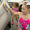 The Lunenburg Bengals cheerleading team held a car wash funraiser in the parking lot of Central Mass Powersports for the sixth year on Saturday, August 3, 2019. They are a big sponsor of the team. The team is made up of kids from kindergarten to eighth grade. Raegan Bishop, 6, helps make sure this car was clean during the fundraiser. SENTINEL & ENTERPRISE/JOHN LOVE