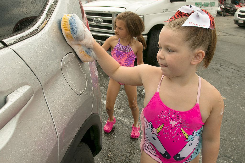 . The Lunenburg Bengals cheerleading team held a car wash funraiser in the parking lot of Central Mass Powersports for the sixth year on Saturday, August 3, 2019. They are a big sponsor of the team. The team is made up of kids from kindergarten to eighth grade. Raegan Bishop, 6, helps make sure this car was clean during the fundraiser. SENTINEL & ENTERPRISE/JOHN LOVE