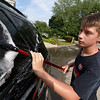 The Lunenburg Skate Park project held a funraising car wash on Friday night out in front of the Eagle House Senior Center. They presold about 70 tickets to the funraiser. Chris roy one of the helpers at the event washes the windows on one of the cars that came through.SENTINEL & ENTERPRISE/JOHN LOVE