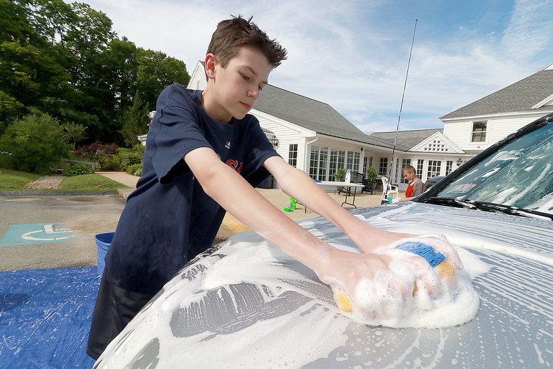 The Lunenburg Skate Park project held a funraising car wash on Friday night out in front of the Eagle House Senior Center. They presold about 70 tickets to the funraiser. Ricky Mankiewscz, 14, one of the helpers at the event washes a hood on one of the cars that came through.SENTINEL & ENTERPRISE/JOHN LOVE