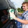 The Lunenburg Skate Park project held a funraising car wash on Friday night out in front of the Eagle House Senior Center. They presold about 70 tickets to the funraiser. Grtiffin Caiozzo one of the helpers at the event washes the windows on one of the cars that came through.SENTINEL & ENTERPRISE/JOHN LOVE