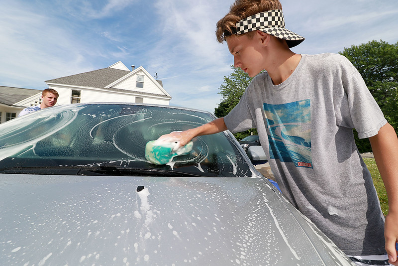 The Lunenburg Skate Park project held a funraising car wash on Friday night out in front of the Eagle House Senior Center. They presold about 70 tickets to the funraiser. Seth Tardie one of the helpers at the event washes the windsheld on one of the cars that came through.SENTINEL & ENTERPRISE/JOHN LOVE