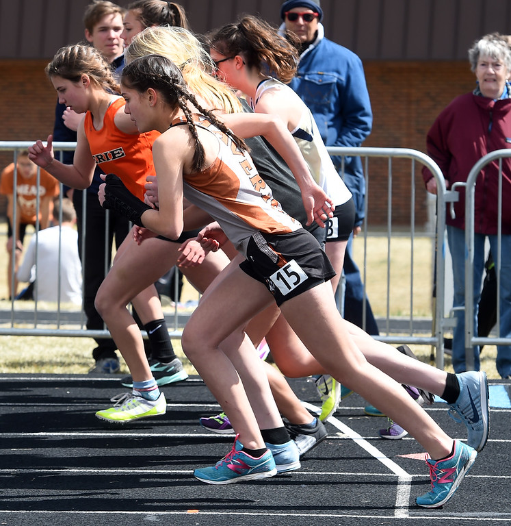 . Olivia Roberts (15) of Mead, starts with other runners in the first heat of the 1600 meters during the Lyons Invitational track meet on Saturday. For more photos, go to BoCoPreps.com. Cliff Grassmick  Photographer  March 31, 2018